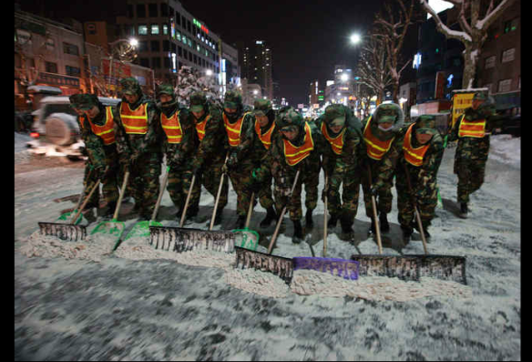 korean military shoveling snow